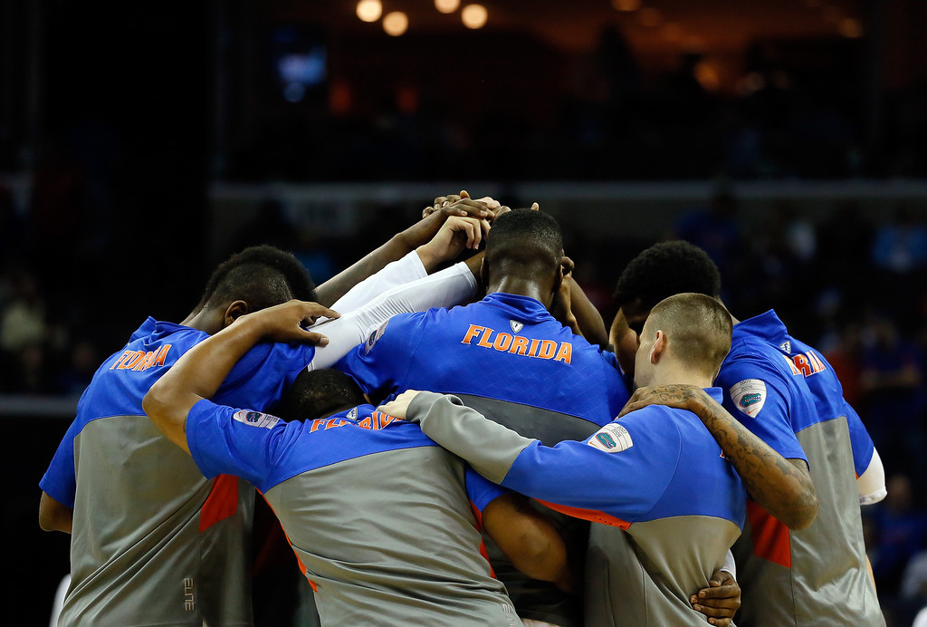 . The Florida Gators huddle prior to a regional semifinal of the 2014 NCAA Men\'s Basketball Tournament against the UCLA Bruins at the FedExForum on March 27, 2014 in Memphis, Tennessee.  (Photo by Kevin C. Cox/Getty Images)