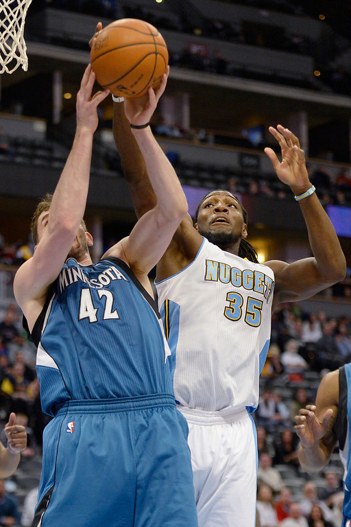 . Kenneth Faried (35) of the Denver Nuggets defends Kevin Love (42) of the Minnesota Timberwolves during the second half of the Timberwolves\' 132-128 win at the Pepsi Center.   (Photo By AAron Ontiveroz/The Denver Post)