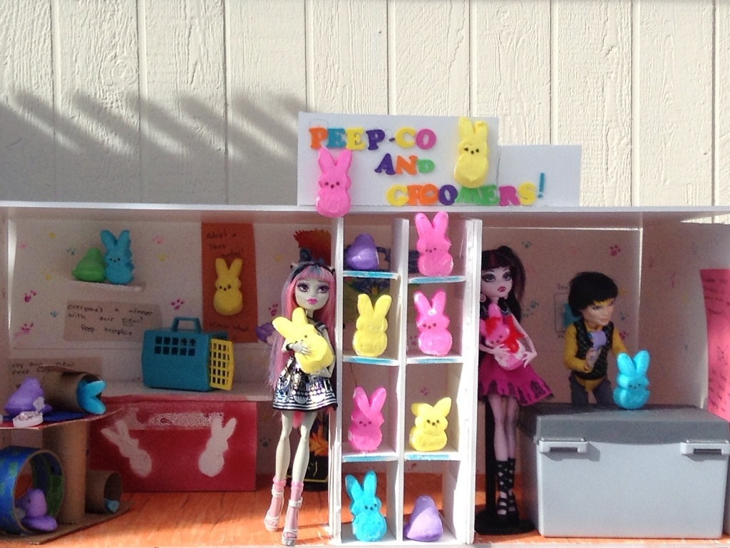 . This picture is a take on Petco the pet store. The dolls are from Mattel\'s Monster High. Mackenzie Johnson