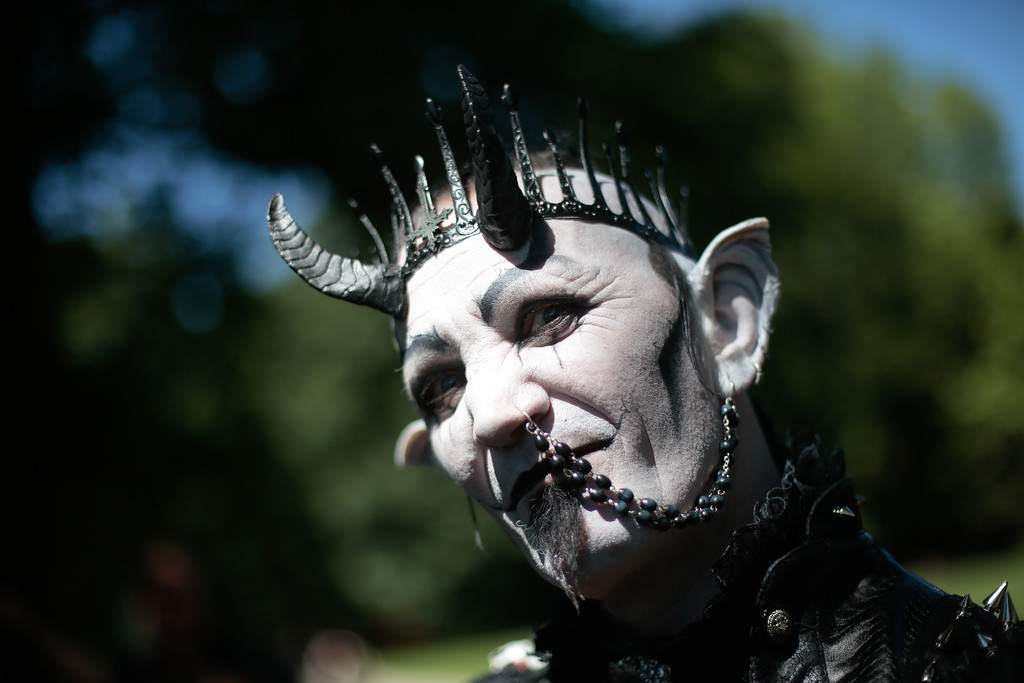 . A participant of the Wave Gothic Festival arrives for the \'Victorian Picnic\' in Leipzig, central Germany, Friday, June 6, 2014.  About 20,000 members of  the Gothic  and Dark Wave scene from all over the world are expected to attend  the 23rd edition of the Wave Gothic Music  Festival .  (AP Photo/Markus Schreiber)