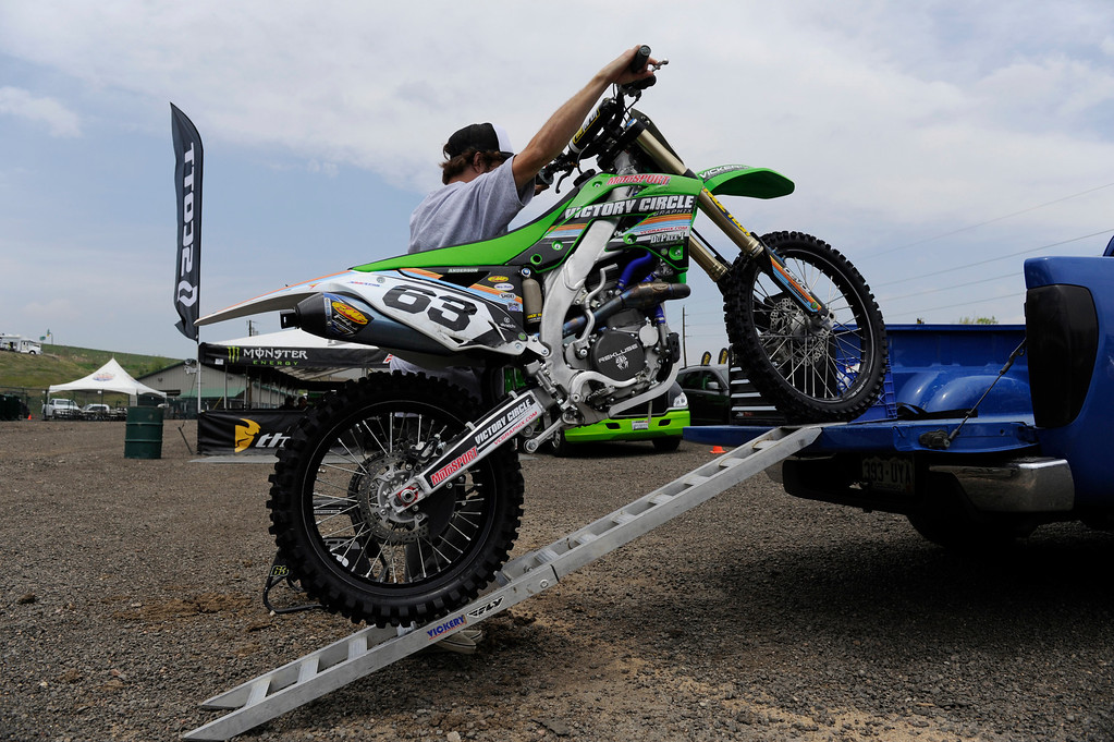 . LAKEWOOD, CO - MAY 23:  Local professional motocross rider, Derek Anderson, from Arvada Colorado, unloads his motocross bike from his pick-up truck to prepare for a practice run on media day at the AMA Thunder Valley National at the Thunder Valley Motocross Park in Lakewood Colorado, Thursday May 23, 2013. The main AMA event is this Saturday at Thunder Valley. (Photo By Andy Cross/The Denver Post)