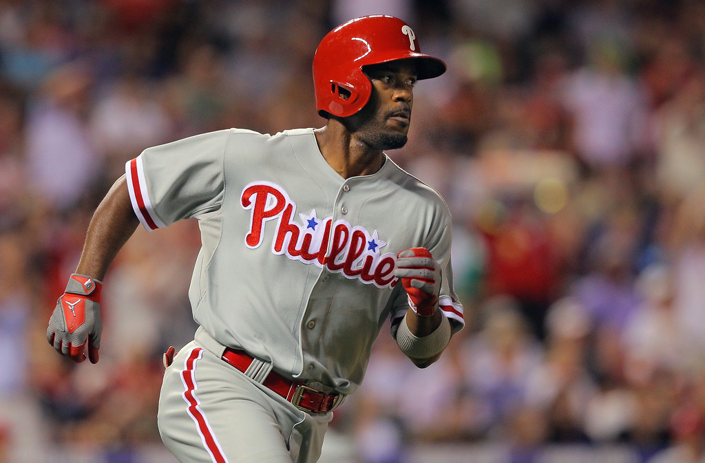 . DENVER, CO - JUNE 14:  Jimmy Rollins #11 of the Philadelphia Phillies heads for first base as he hits a pinch hit RBI single to score Freddy Galvis #13 of the Philadelphia Phillies and take an 8-7 lead over the Colorado Rockies in the seventh inning at Coors Field on June 14, 2013 in Denver, Colorado.  (Photo by Doug Pensinger/Getty Images)