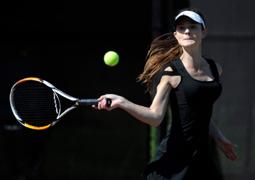 . Shannon Hickey from Castle View High School returns the ball to Bria Smith from East High School in the #1 Singles Bracket. (Photo By Kathryn Scott Osler/The Denver Post)