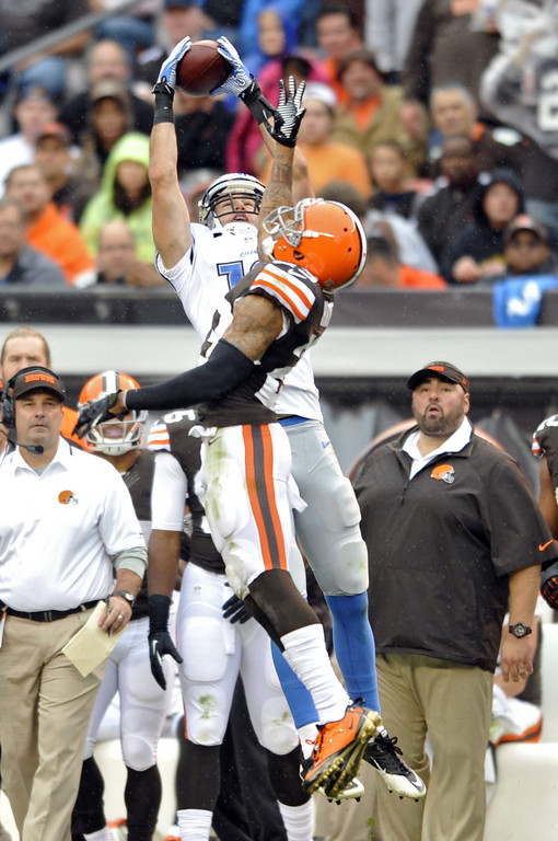 . Detroit Lions wide receiver Kris Durham makes a catch for a first down over Cleveland Browns cornerback Joe Haden in the second quarter of an NFL football game Sunday, Oct. 13, 2013 in Cleveland. (AP Photo/David Richard)