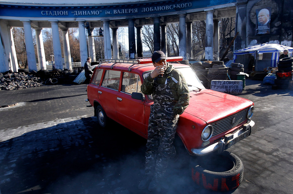 . A Ukrainian man, veteran of the Maidan movement, drinks a cup of hot tea as he guards the first barricade that was erected by protesters, in front of Dinamo Stadium burned entrance, in Kiev, Ukraine, 14 March 2014. Ukraine\'s Parliament backed on 13 March the creation of a new National Guard of 60,000 volunteers to supplement its conventional army forces, consisting of 130,000 soldiers. Ukrainian volunteers crowded the recruitment centers in response to the mobilization call, related to the Russian maneuvers in Crimean peninsula. The USA and European Union have threatened sanctions against Moscow over the military standoff in the strategic Crimean peninsula, and are urging Russia to pull back its forces in the region and allow in international observers and human rights monitors. Crimea, which has a majority ethnic Russian population, is strategically important to Russia as the home port of its Black Sea Fleet.  EPA/ROBERT GHEMENT