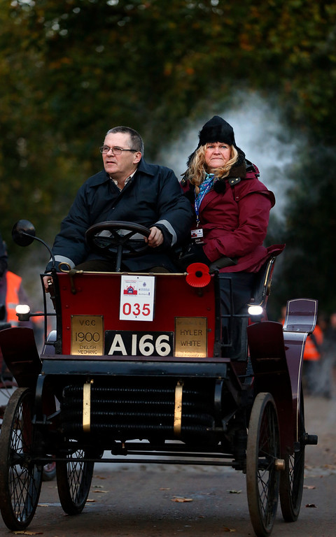 . Participants drive their 1900 English Mechanic car at the start line in London\'s Hyde Park, during the London to Brighton Veteran Car Run, Sunday, Nov. 3, 2013. Over 400 pre-1905 vehicles made their way on the historic 60-mile run from Hyde Park in London to coastal Brighton in southern England, in the world\'s longest running motoring celebration spanning 117 years. (AP Photo/Lefteris Pitarakis)