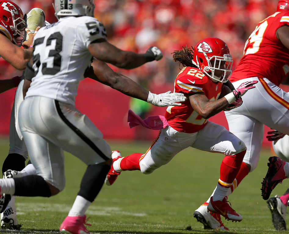 . Kansas City Chiefs wide receiver Dexter McCluster (22) breaks past Oakland Raiders middle linebacker Nick Roach (53) during the second half of an NFL football game at Arrowhead Stadium in Kansas City, Mo., Sunday, Oct. 13, 2013. (AP Photo/Ed Zurga)