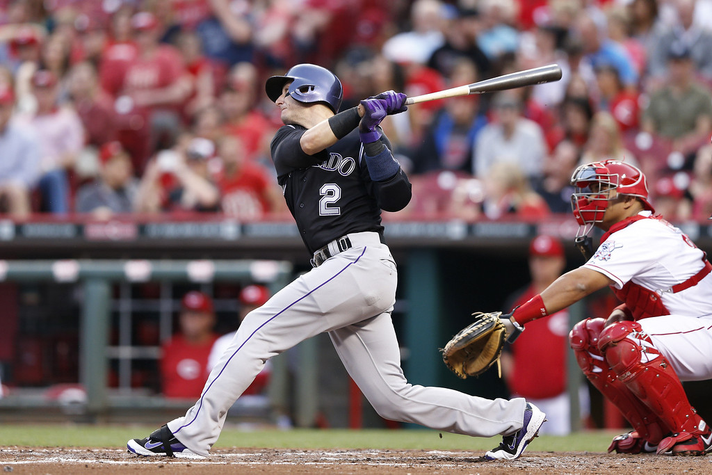 . CINCINNATI, OH - MAY 9:  Troy Tulowitzki #2 of the Colorado Rockies hits a home run in the top of the fourth inning of the game against the Cincinnati Reds at Great American Ball Park on May 9, 2014 in Cincinnati, Ohio. (Photo by Joe Robbins/Getty Images)