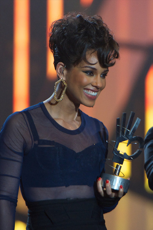 ". Alicia Keys performs on stage during \""40 Principales Awards\"" 2012 at Palacio de los Deportes on January 24, 2013 in Madrid, Spain.  (Photo by Carlos Alvarez/Getty Images)"