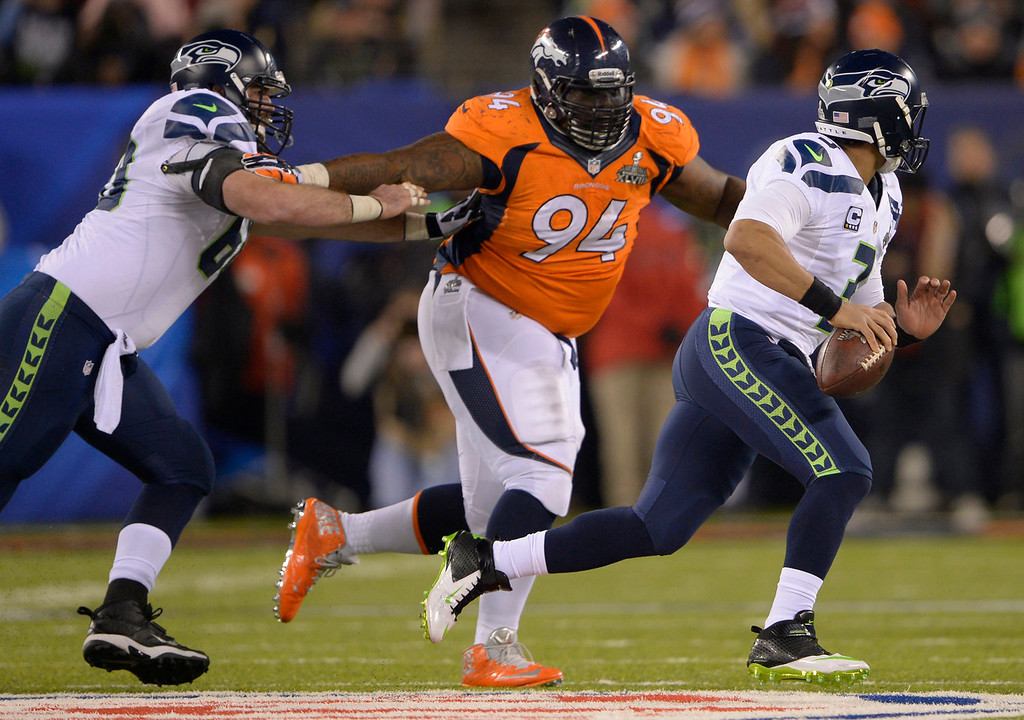 . Denver Broncos defensive tackle Terrance Knighton (94) chases Seattle Seahawks quarterback Russell Wilson (3) during the fourth quarter. The Denver Broncos vs the Seattle Seahawks in Super Bowl XLVIII at MetLife Stadium in East Rutherford, New Jersey Sunday, February 2, 2014. (Photo by Joe Amon/The Denver Post)