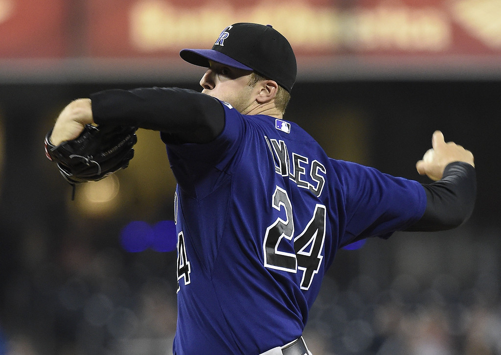 . Jordan Lyles #24 of the Colorado Rockies pitches during the first inning of a  baseball game against the San Diego Padres at Petco Park April 14, 2014 in San Diego, California.  (Photo by Denis Poroy/Getty Images)