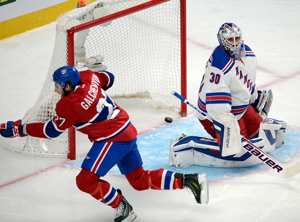 . Montreal Canadiens\' Alex Galchenyuk celebrates after scoring on New York Rangers goalie Henrik Lundqvist during the first period of Game 5 of the NHL hockey Stanley Cup playoffs Eastern Conference finals, Tuesday, May 27, 2014, in Montreal. (AP Photo/The Canadian Press, Ryan Remiorz)