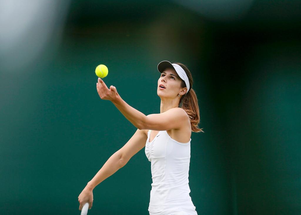 . Tsvetana Pironkova of Bulgaria serves to Anastasia Pavlyuchenkova of Russia in their women\'s singles tennis match at the Wimbledon Tennis Championships, in London June 25, 2013.  REUTERS/Stefan Wermuth