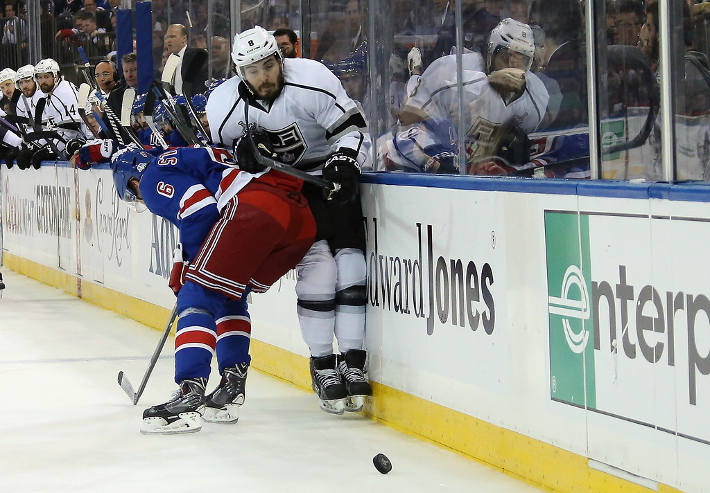 . Anton Stralman #6 of the New York Rangers hipchecks Drew Doughty #8 of the Los Angeles Kings during the first period of Game Four of the 2014 NHL Stanley Cup Final at Madison Square Garden on June 11, 2014 in New York, New York.  (Photo by Bruce Bennett/Getty Images)