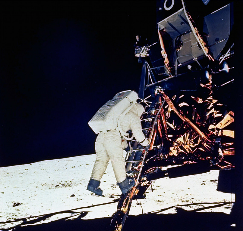 . Astronaut Edwin E. Aldrin, Jr., lunar module pilot, descends steps of Lunar Module ladder as he prepares to walk on the moon, July 20, 1969. This picture was taken by astronaut Neil A. Armstrong, Commander, with a 70mm surface camera. (AP Photo/NASA/Neil A. Armstrong)