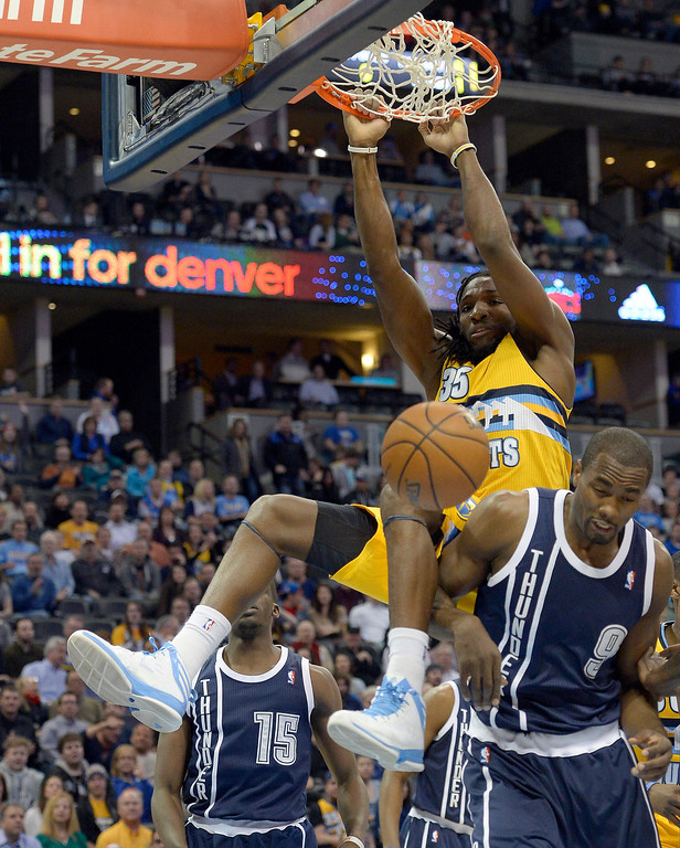 . Denver Nuggets power forward Kenneth Faried (35) gets an easy dunk pas Oklahoma City Thunder power forward Serge Ibaka (9) during the first quarter January 9, 2014 at Pepsi Center. (Photo by John Leyba/The Denver Post)