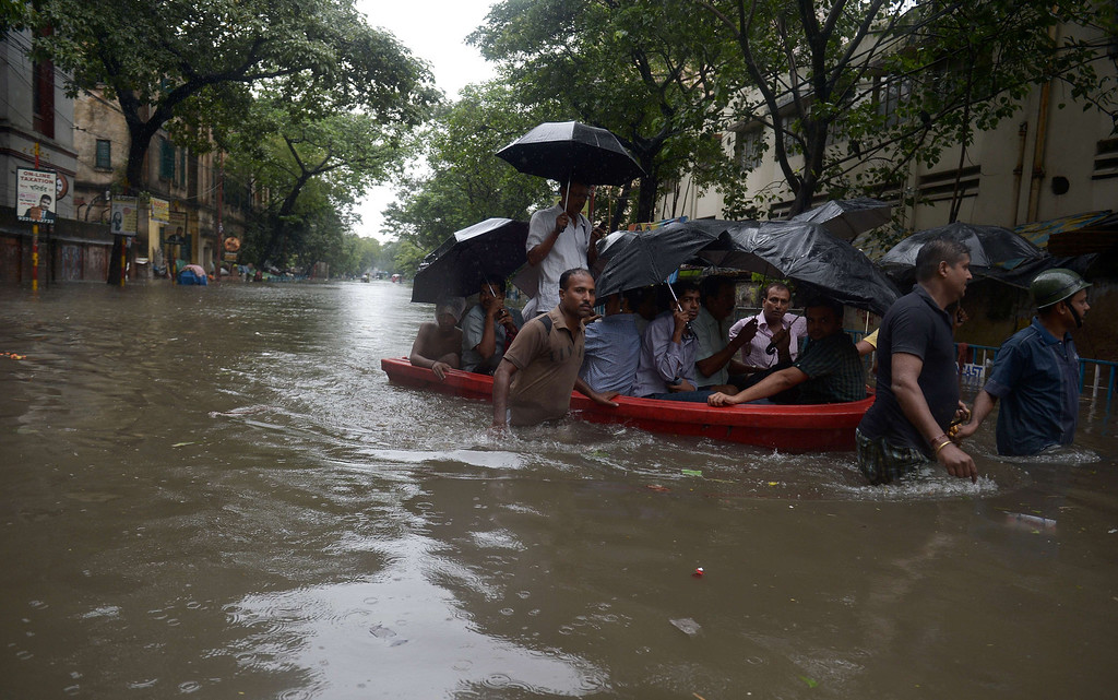 . Indian Police officials pull a boat through water-logged streets as they ferry residents to a safer place in Kolkata on October 26, 2013.  Persistent rain for the last 24 hours has thrown normal life in this metropolis out of gear with reports of waterlogging at major arterial roads of the city which received 14 cm rainfall, the highest rainfall during the ongoing depression in eastern India.  Weathermen predicted that the rain, caused due to a depression off Andhra coast over Bay of Bengal, would continue for at least next 24 hours. DIBYANGSHU SARKAR/AFP/Getty Images