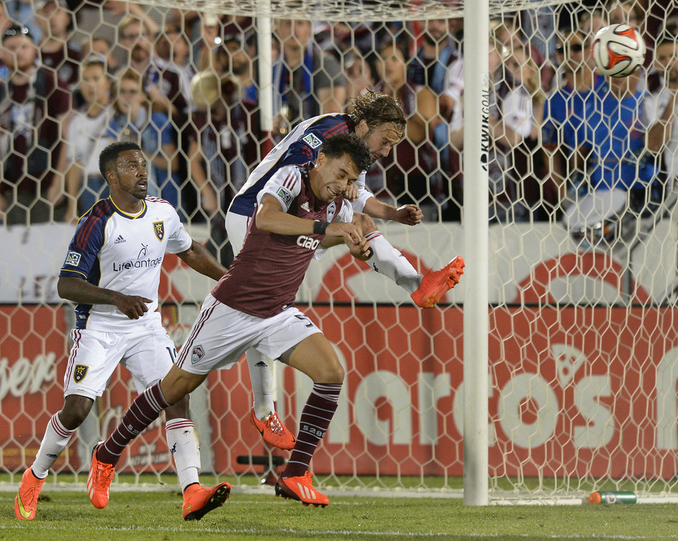 . COMMERCE CITY, CO - AUGUST 2: Salt Lake midfielder Ned Grabavoy headed the ball away from Colorado\'s Gabriel Torres on a corner kick in the second half. Real Salt Lake defeated the Colorado Rapids 1-0 at Dick\'s Sporting Goods Park Saturday night, August 2, 2014.  Photo by Karl Gehring/The Denver Post