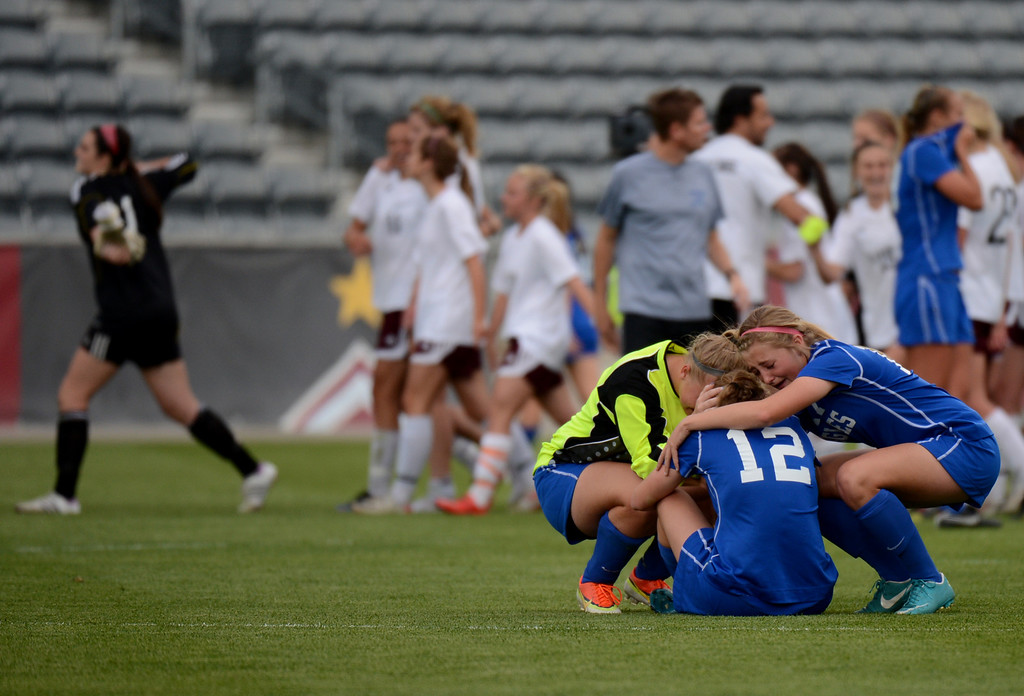 . COMMERCE CITY, CO. - MAY 22 : From front left, Paige Lindbloom (1), Lauren Snyder (12) and Makena Bambei of Broomfield High School (17) comfort each other after losing 4A girl\'s soccer championship game against Cheyenne Mountain High School at Dick\'s Sporting Goods Park. Commerce City, Colorado. May 22, 2013. Cheyenne Mountain High School won 2-0. (Photo By Hyoung Chang/The Denver Post)