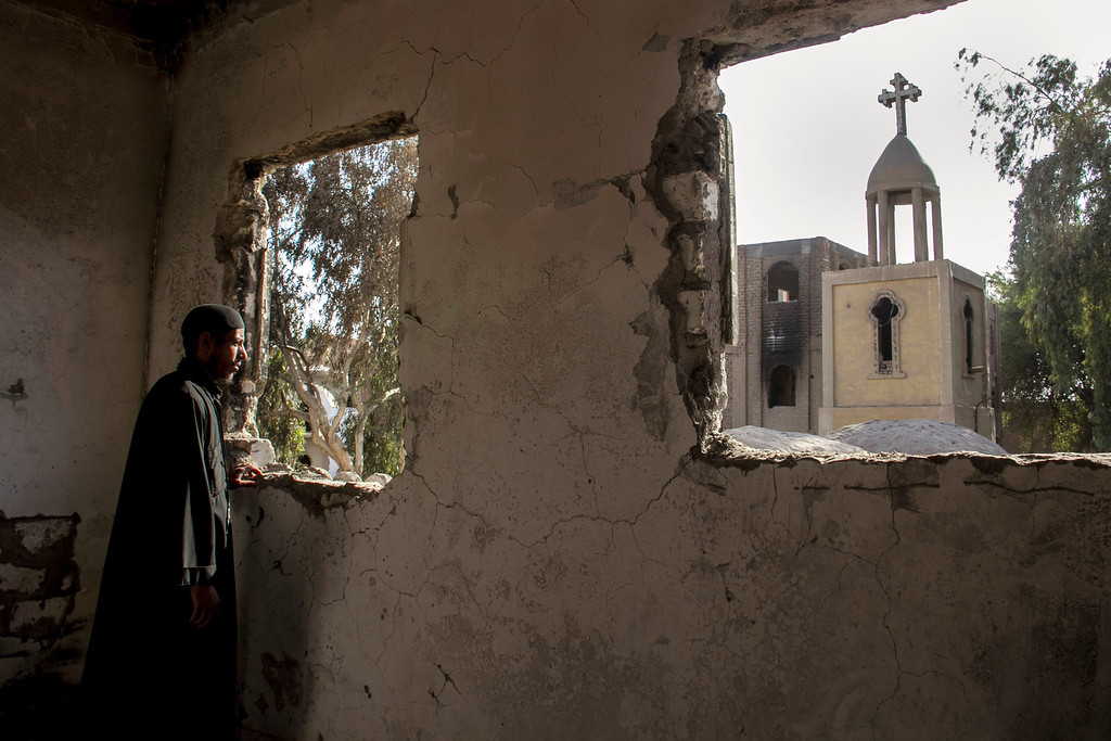 . In this Sept. 3, 2013 photo, Egyptian priest Samuel Zaki views the damaged main church inside the Virgin Mary and St. Abraam Monastery that was looted and burned by Islamists, in Dalga, Minya province, Egypt. Dalga has been outside government control since hard-line supporters of the Islamist Mohammed Morsi drove out police and occupied their station on July 3, the day Egypt\'s military chief removed the president in a popularly supported coup. It was part of a wave of attacks in the southern Minya province that targeted Christians, their homes and businesses. (AP Photo/El Shorouk Newspaper, Roger Anis)