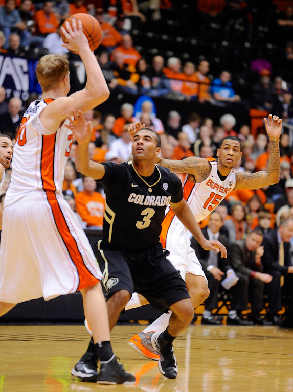 . Colorado\'s Xavier Talton (3) loses the ball to Oregon State\'s Olaf Schaftenaar (30) during the first half of an NCAA college basketball game in Corvallis, Ore., Sunday, Feb. 10, 2013. (AP Photo/Greg Wahl-Stephens)