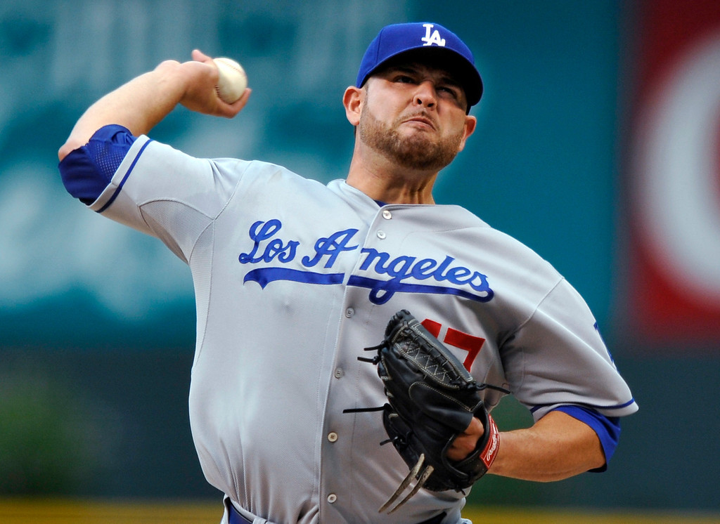 . Los Angeles Dodgers starting pitcher Ricky Nolasco throws to a Colorado Rockies batter during the first inning of a baseball game, Tuesday, Sept. 3, 2013, in Denver. (AP Photo/Jack Dempsey)