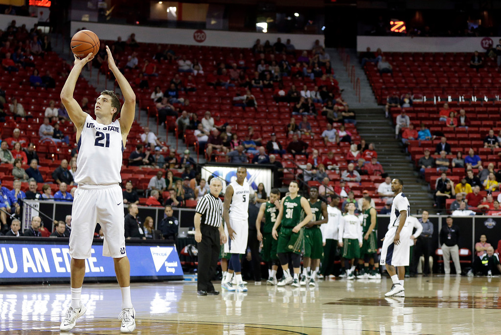 . Utah State\'s Spencer Butterfield shoots a free throw after a technical foul on Daniel Bejarano during the second half of a Mountain West Conference tournament NCAA college basketball game Wednesday, March 12, 2014, in Las Vegas. Utah State defeated Colorado State 73-69. (AP Photo/Isaac Brekken)