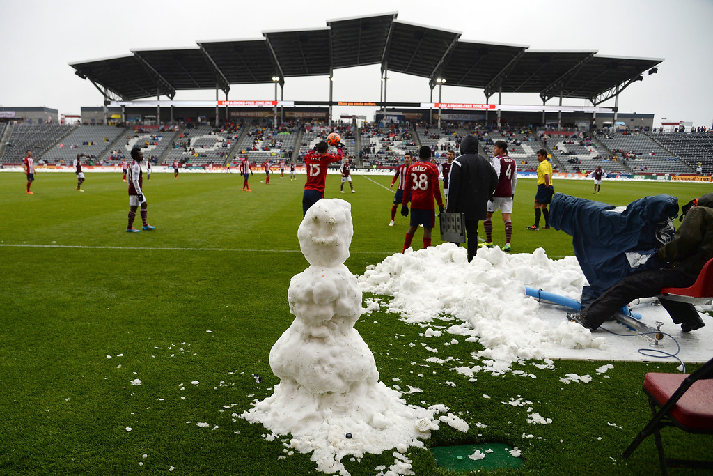 . A snowman stands on the sidelines as Eric Avila (15) of Chivas USA inbounds a pass against the Colorado Rapids during the second half. Chivas USA defeated the Colorado Rapids 3-1 on Sunday, May 11, 2014. (Photo by AAron Ontiveroz/The Denver Post)
