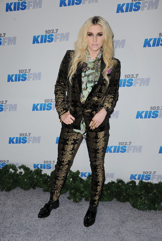 . K$sha arrives at KIIS FM\'s Jingle Ball at Nokia Theatre LA Live on Monday, Dec. 3, 2012, in Los Angeles. (Photo by Katy Winn/Invision/AP)