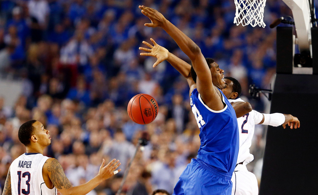 . Kentucky center Dakari Johnson (44) loses control of the ball under pressure from Connecticut forward DeAndre Daniels (2) as Connecticut guard Shabazz Napier (13) comes in for the loose ball during the second half of play in the  2014 NCAA Division I men\'s basketball championship at AT&T Stadium in Arlington, Texas on Monday, April 7, 2014. (AP Photo/The Dallas Morning News,Vernon Bryant)