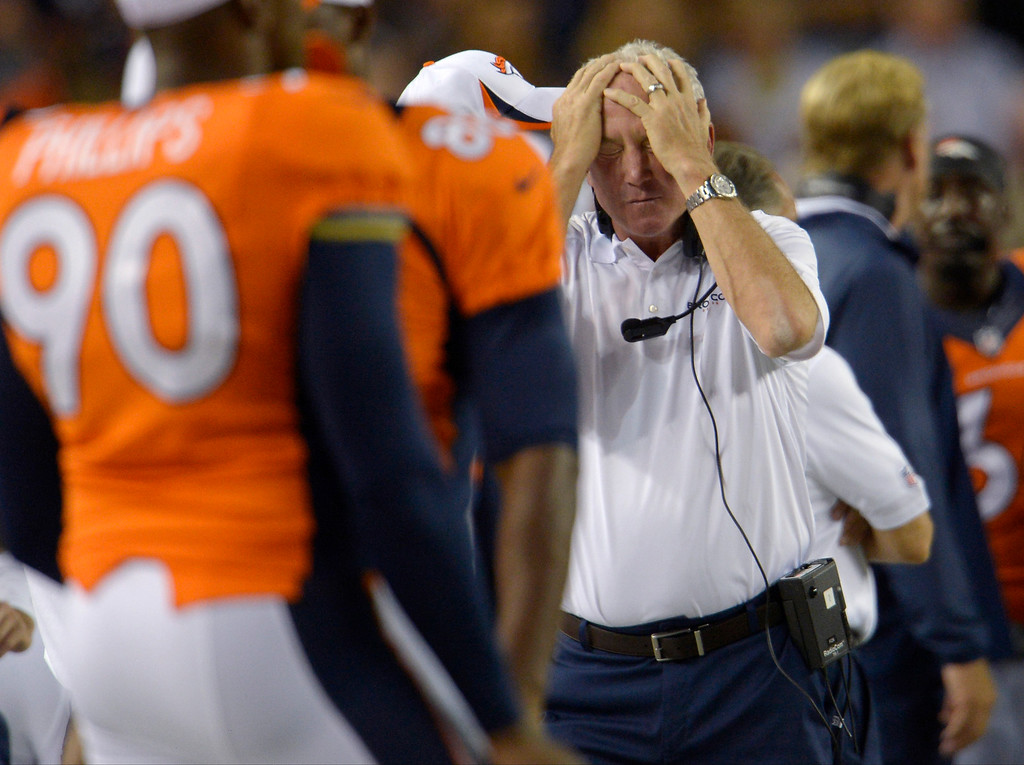 . Head coach John Fox of the Denver Broncos rubs his head as his team plays the Arizona Cardinals during the last pre-season game of the season at Sports Authority Field at Mile High. August 29, 2013 Denver, Colorado. (Photo By Joe Amon/The Denver Post)