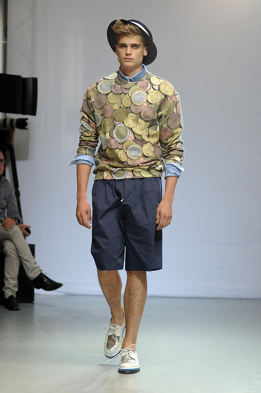 . A model walks the runway at the Frankie Morello show during Milan Menswear Fashion Week Spring Summer 2014 on June 25, 2013 in Milan, Italy.  (Photo by Stefania D\'Alessandro/Getty Images)