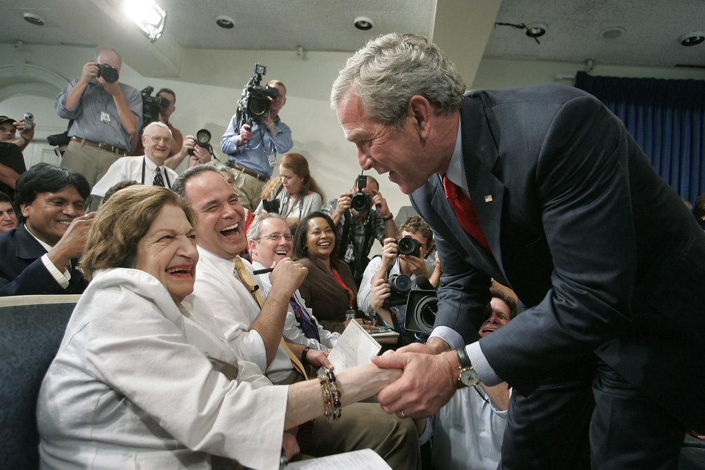 . In this Aug. 2, 2006 file photo, President Bush, right, greets veteran White House correspondent Helen Thomas during the final briefing in the press briefing room in the West Wing of the White House in Washington before its renovation. Thomas abruptly retired Monday, according to her employer, Hearst News Service.  (AP Photo/Charles Dharapak)