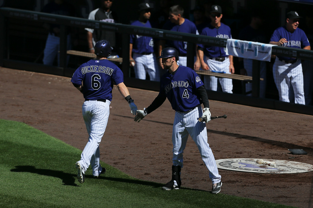 . DENVER, CO - SEPTEMBER 3:  Corey Dickerson #6 of the Colorado Rockies is congratulated by Ben Paulsen #4 after hitting a solo home run during the fifth inning against the San Francisco Giants  at Coors Field on September 3, 2014 in Denver, Colorado. (Photo by Justin Edmonds/Getty Images)