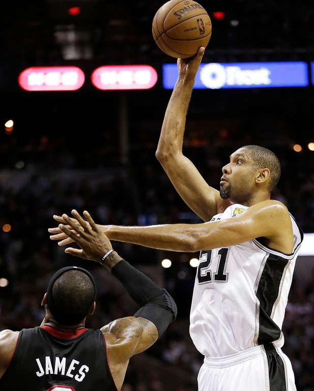 . San Antonio Spurs\' Tim Duncan (21) shoots over Miami Heat\'s LeBron James (6) during the first half at Game 5 of the NBA Finals basketball series, Sunday, June 16, 2013, in San Antonio. (AP Photo/Eric Gay)