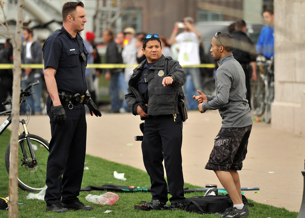 . DENVER, CO. - APRIL 20 : Denver Police officers secure and investigating the shooting site. Two people were shot in Denver\'s Civic Center during Saturday\'s pot rally, according to paramedics on the scene. Denver, Colorado. April 20, 2013. (Photo By Hyoung Chang/The Denver Post)