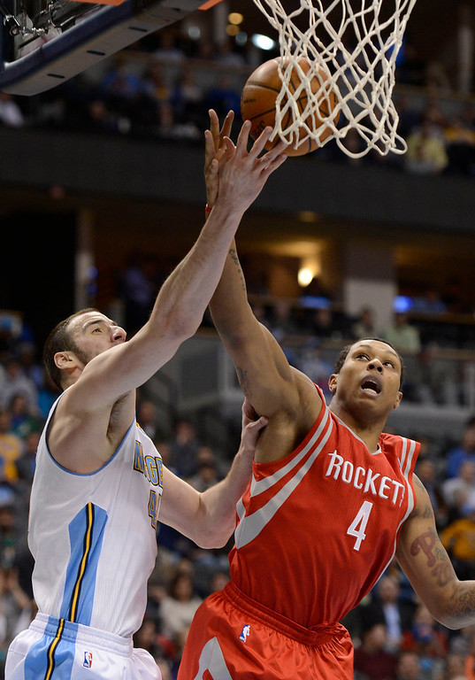 . DENVER, CO. - JANUARY 30: Denver Nuggets center Kosta Koufos (41) battles for a rebound with Houston Rockets power forward Greg Smith (4) during the second quarter January 30, 2013 at Pepsi Center. The Denver Nuggets take on the Houston Rockets in NBA action. (Photo By John Leyba/The Denver Post)