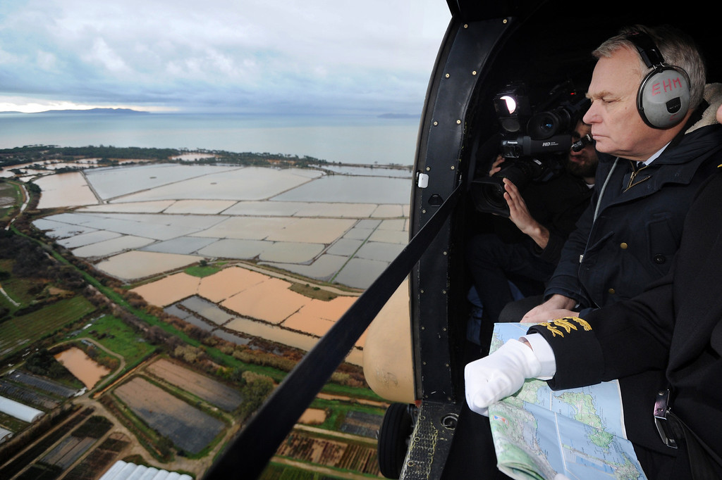 . French Prime minister Jean-Marc Ayrault\'s helicopter flies over flooded areas between La Londes-les-Maures and Hy�res, southern France, Monday, Dec. 20, 2014. Unusually heavy rains have flooded the French Riviera, leaving two people dead and thousands without electricity or access to roads. The administration for the Var region evacuated some residents and urged others to stay indoors until the waters recede. (AP Photo/ Anne-Christine Poujoulat, Pool)
