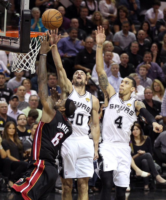 . LeBron James #6 of the Miami Heat goes up for a shot against Manu Ginobili #20 and Danny Green #4 of the San Antonio Spurs in the first half during Game Four of the 2013 NBA Finals at the AT&T Center on June 13, 2013 in San Antonio, Texas.  (Photo by Christian Petersen/Getty Images)