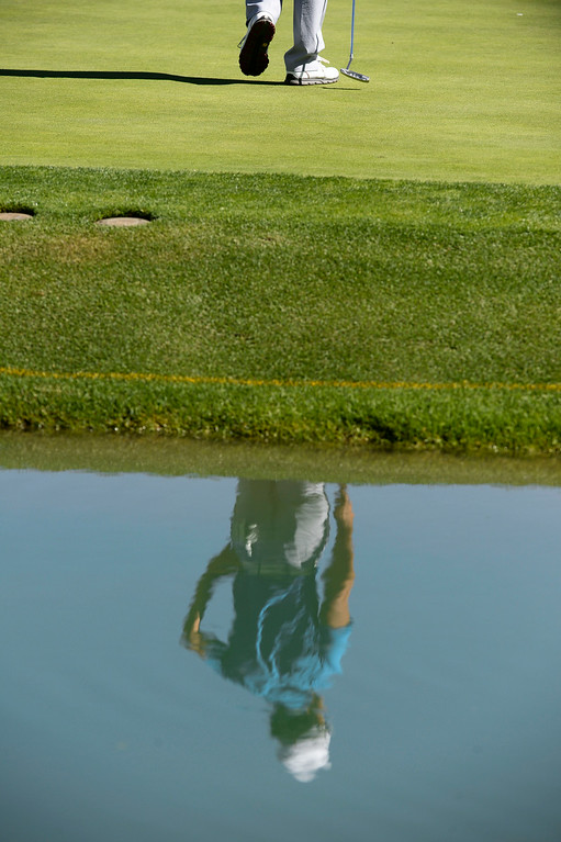 . CHERRY HILLS VILLAGE, CO. - SEPTEMBER 03:  Pro golfer, Kevin Na, with putter in hand, walks to putt on the 17th green, which is surrounded by a moat at during the FedExCup BMW Championship Pro-Am at the Cherry Hills Country Club Wednesday, September 03, 2014. (Photo By Andy Cross / The Denver Post)