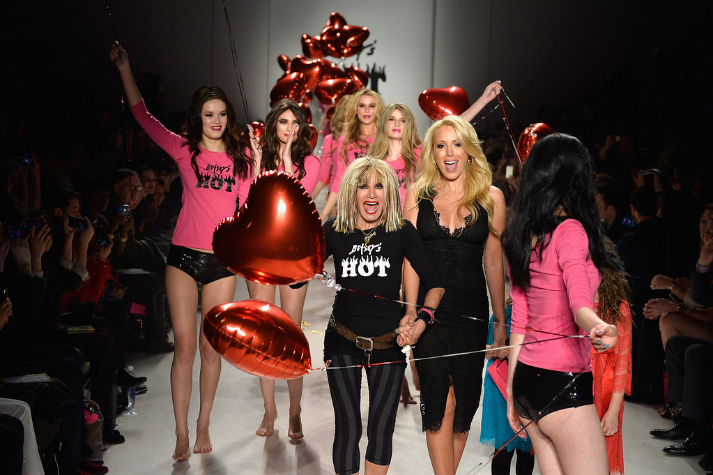 . Designer Betsey Johnson walks the runway with her daughter LuLu Johnson and granddaughters Ella and Layla at the Betsey Johnson fashion show during Mercedes-Benz Fashion Week Fall 2014 at The Salon at Lincoln Center on February 12, 2014 in New York City.  (Photo by Frazer Harrison/Getty Images for Mercedes-Benz Fashion Week)