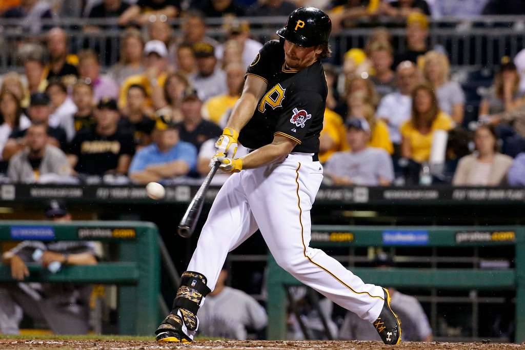 . Pittsburgh Pirates\' Travis Snider drives in the go-ahead run with a double off Colorado Rockies relief pitcher Matt Belisle during the eighth inning of a baseball game in Pittsburgh on Friday, July 18, 2014. The Pirates won 4-2. (AP Photo/Gene J. Puskar)
