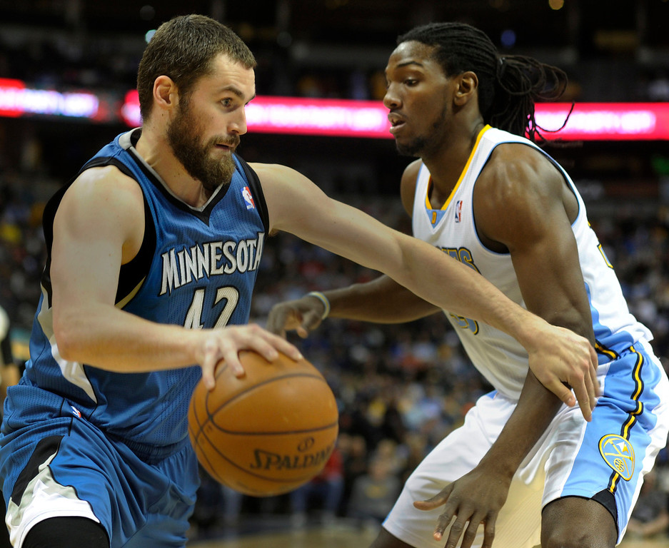 . Wolves forward Kevin Love (42) worked against Kenneth Faried (35) in the first half. The Minnesota Timberwolves took a bite out of the Denver Nuggets winning 101-97 at the Pepsi Center Thursday night, January 3, 2013. Karl Gehring/The Denver Post