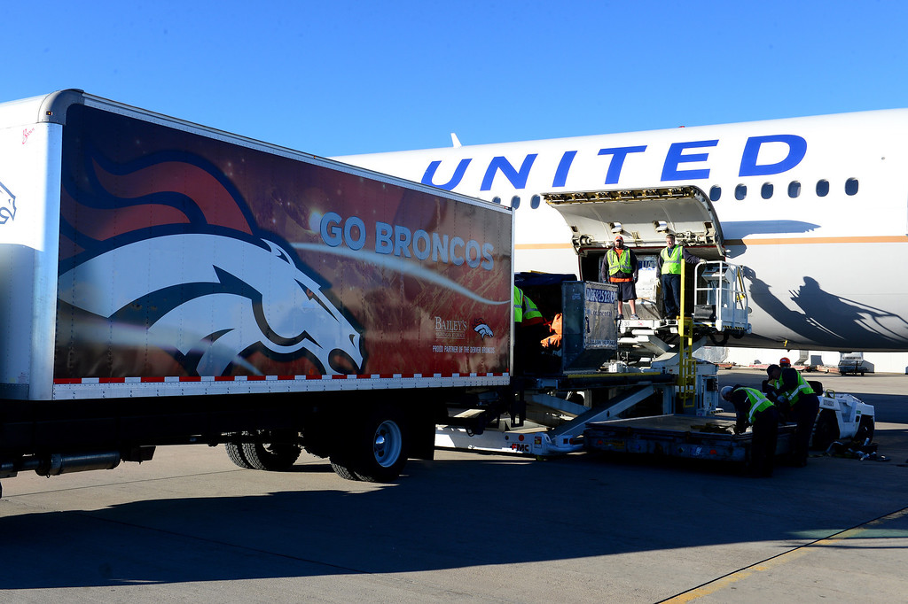 . United employees load the Denver Broncos United plane with gear, food, jerseys etc for the team prior to them arriving at Denver International Airport in Denver, Co on January 26, 2014.  The Denver Broncos team flew out on the United charter plane to head to New Jersey for the Super Bowl in New Jersey.  (Photo By Helen H. Richardson/ The Denver Post)