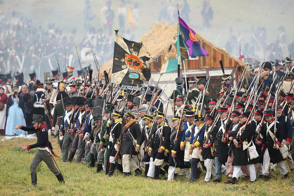 . Historical society enthusiasts in the role of Allied soldiers advance against troops loyal to Napoleon during the re-enactment of The Battle of Nations on its 200th anniversary on October 20, 2013 near Leipzig, Germany.  (Photo by Sean Gallup/Getty Images)