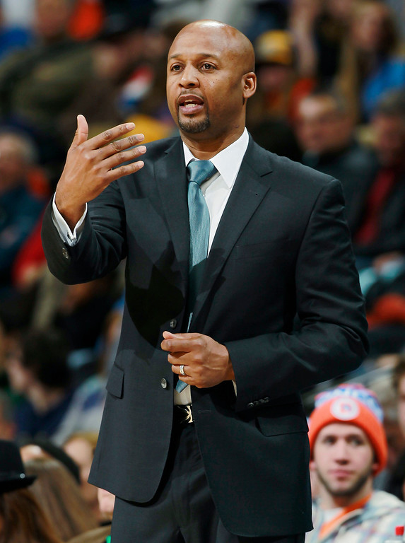 . Denver Nuggets coach Brian Shaw directs his team against the Philadelphia 76ers in the first quarter of an NBA basketball game in Denver on Wednesday, Jan. 1, 2014. (AP Photo/David Zalubowski)