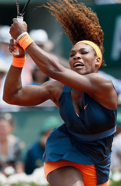 . USA\'s Serena Williams returns a shot to Russia\'s Maria Sharapova during the 2013 French tennis Open final at the Roland Garros stadium in Paris on June 8, 2013. AFP PHOTO / PATRICK KOVARIK/AFP/Getty Images