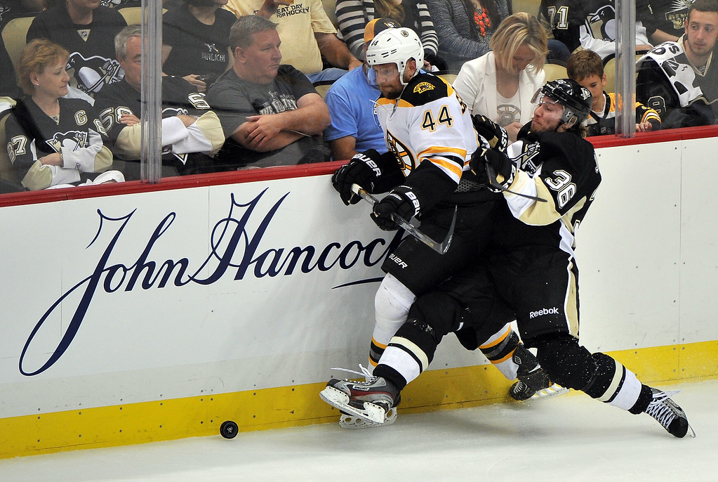 . PITTSBURGH, PA - JUNE 01: Dennis Seidenberg #44 of the Boston Bruins and Jussi Jokinen #36 of the Pittsburgh Penguins battle for the puck during Game One of the Eastern Conference Final of the 2013 NHL Stanley Cup Playoffs at the Consol Energy Center on June 1, 2013 in Pittsburgh, Pennsylvania.  (Photo by Jamie Sabau/Getty Images)
