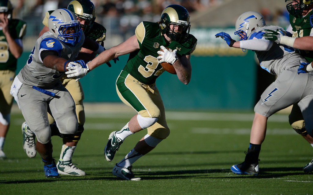 . Colorado State Rams TE, Joe Brown, center, finds running room against Air Force defenders in the fourth quarter  Saturday afternoon, November 30, 2013. (Photo By Andy Cross/The Denver Post)