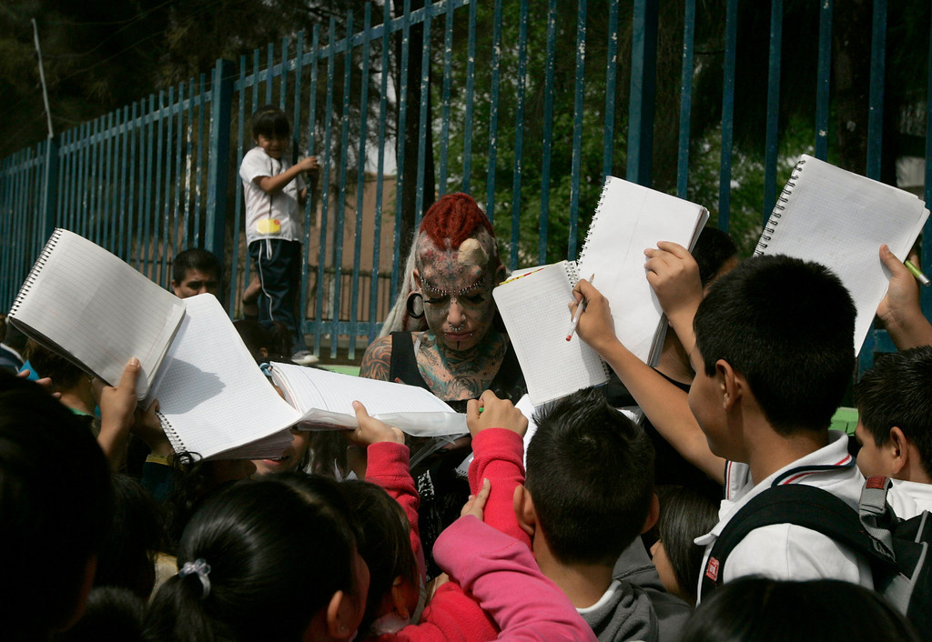 . School children ask Maria Jose Cristerna for autographs while she is waiting for her children to come out of school in Guadalajara February 7, 2012.  REUTERS/Alejandro Acosta